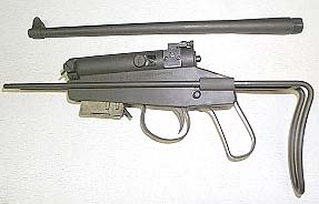 H&R M-4 Survival Gun. U.S. Property marked, .22 Hornet, 6 shot mag. 14
