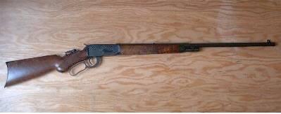 Winchester '94 rifle Half magazine, half octagonal/half round barrel, half pistol grip.