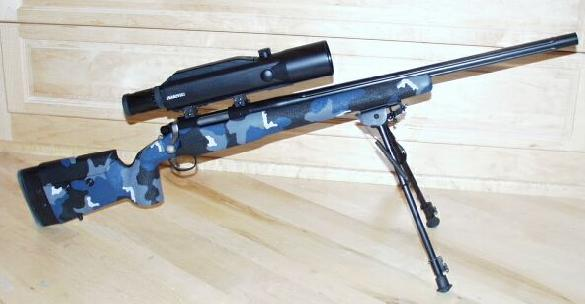 Remington 700 Robar SR 90 with Swarovski LRS scope.