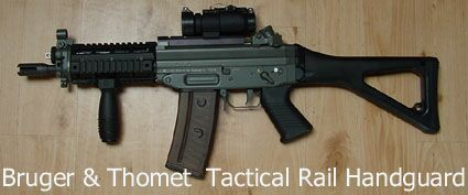 SIG 552 commando with Brugger & Thomet Tactical rail hand guard and aimpoint.