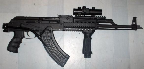 Romanian AK with Romanian folding stock, red dot 1x scope on UTG picatinny rail mount system. and fore-end grip.